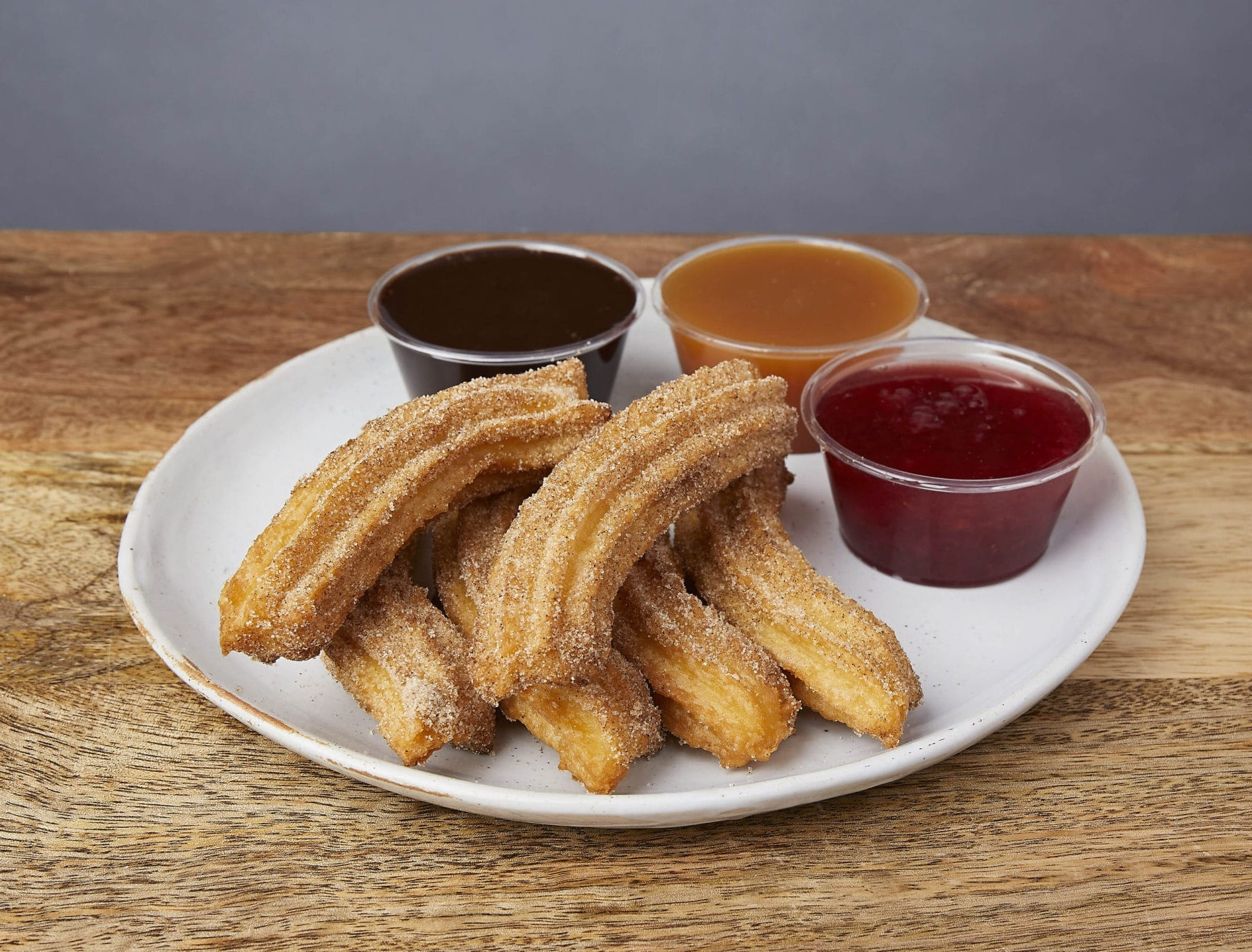 Image of churros with dipping sauces