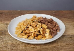 Image of a kids chicken, rice, and beans plate