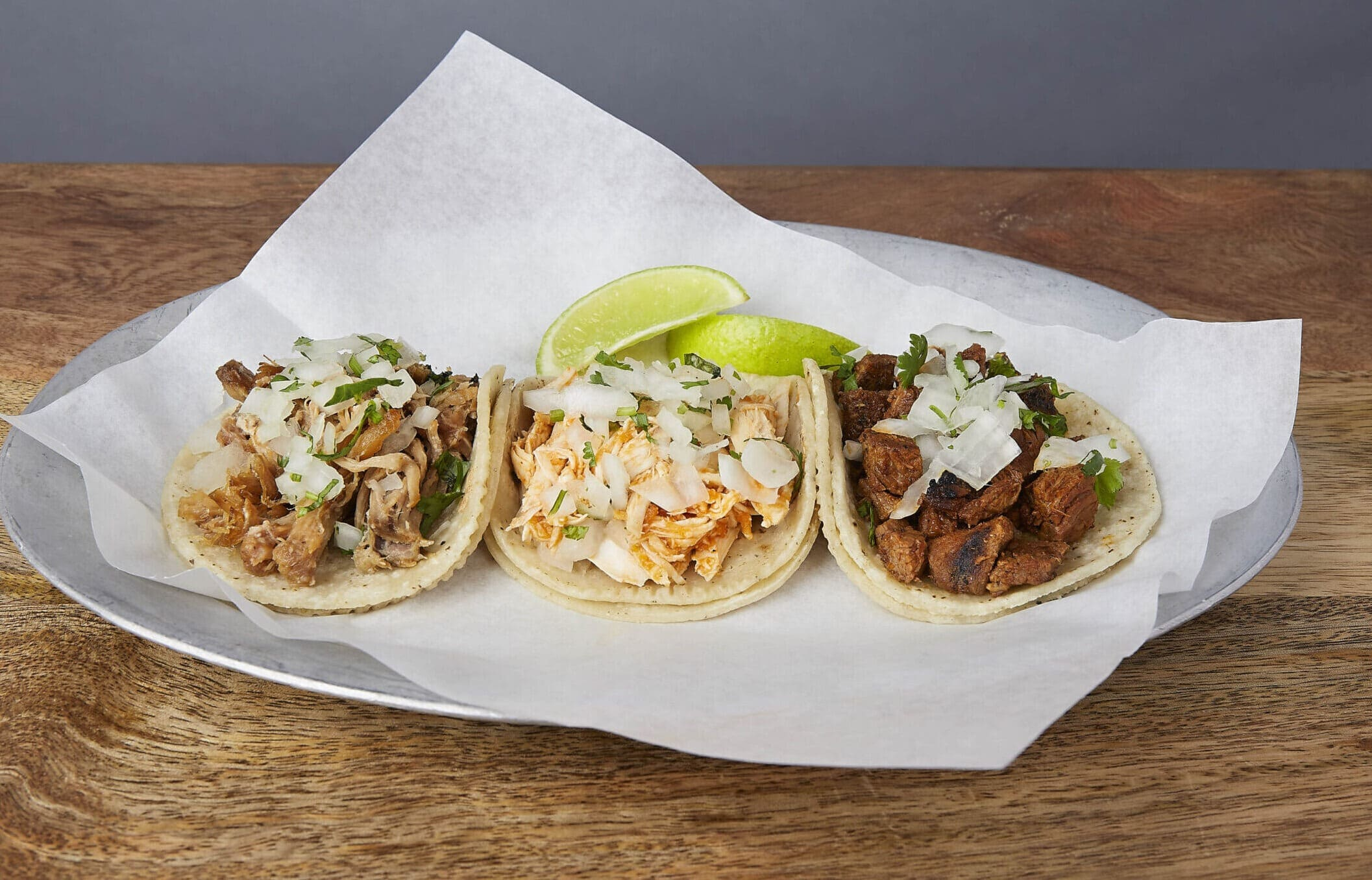 Image of three street style tacos